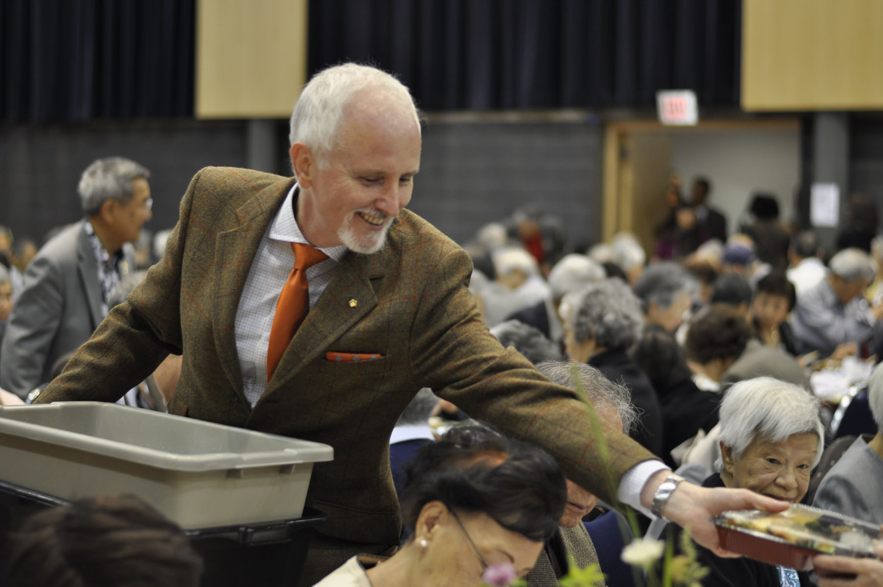 Bentos being served by JCCC Director James Heron inside of the Kobayashi Hall. Photo courtesy: Matthew O'Mara