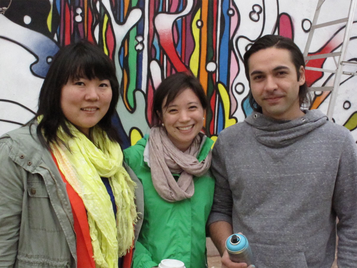 Ken Galloway, on right, stands with Lindsay Tsuji and Jessica Whitehead, left and centre, in front of the giant Japantown mural painted on the side wall of the Sanko Japanese store on Queen St. west. Photo courtesy: Mel Tsuji
